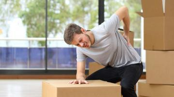 moving hacks man suffering back ache moving boxes in his new house