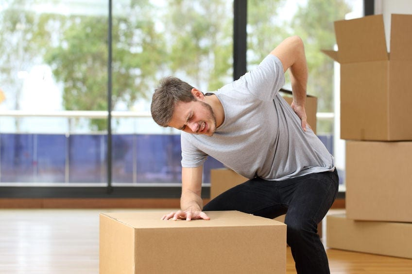 moving hacks avoid suffering back ache moving boxes in his new house