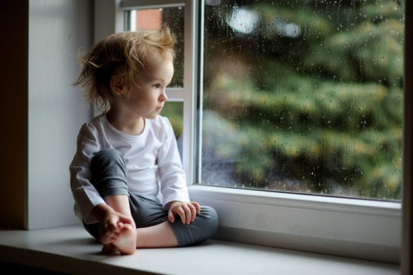 LITTLE KID LOOKING OUT WINDOW